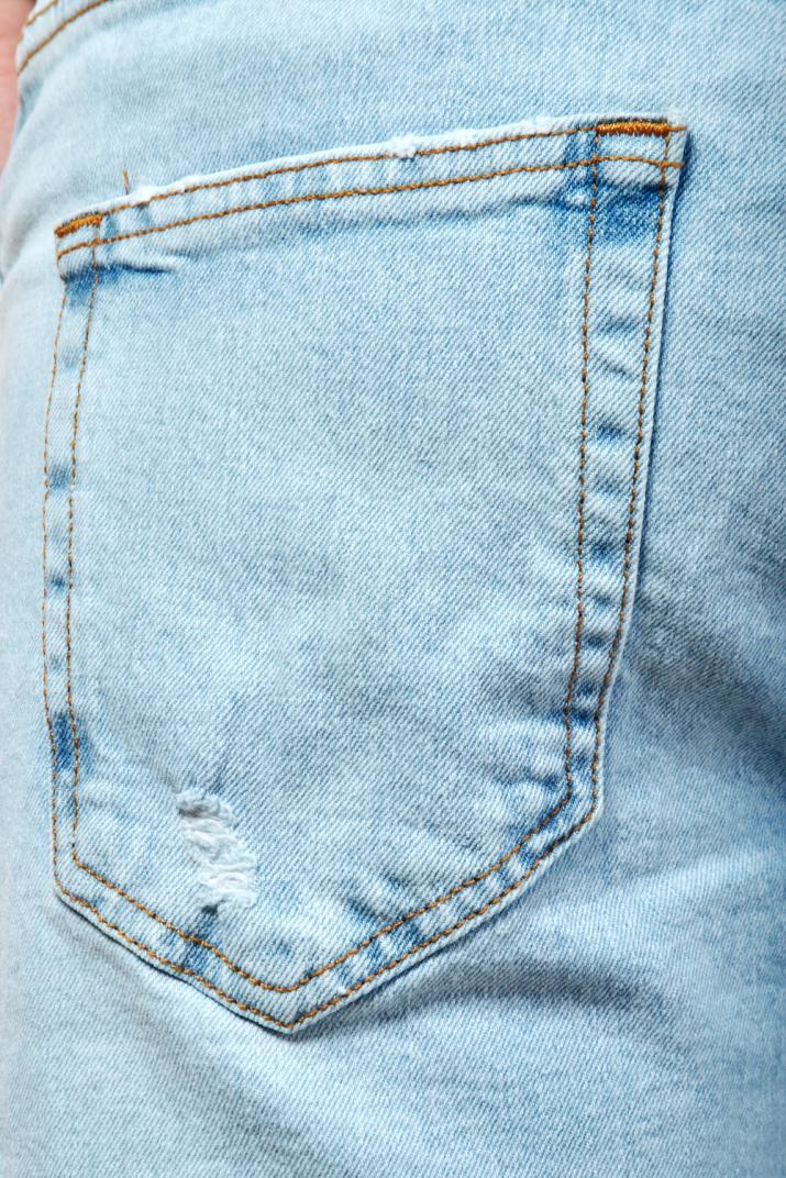 Bermuda Clash Jean elastizada con roturas Slim fit